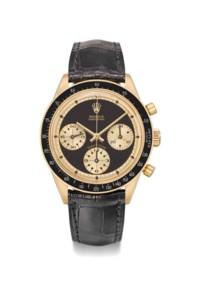 """Rolex. An exceptionally rare and highly attractive 18K gold chronograph wristwatch with black """"John Player Special Paul Newman"""" dial"""